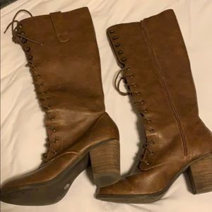 Laced brown leather boots
